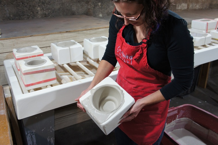 Swirling the clay in the bottom of the mold