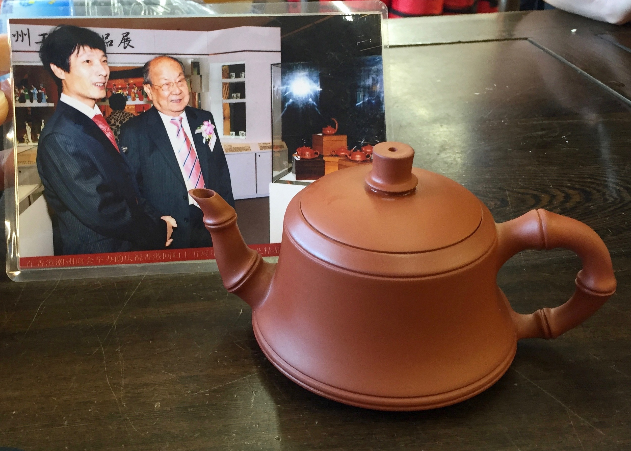 Here is the teapot I purchased. The artist is the man on the left.