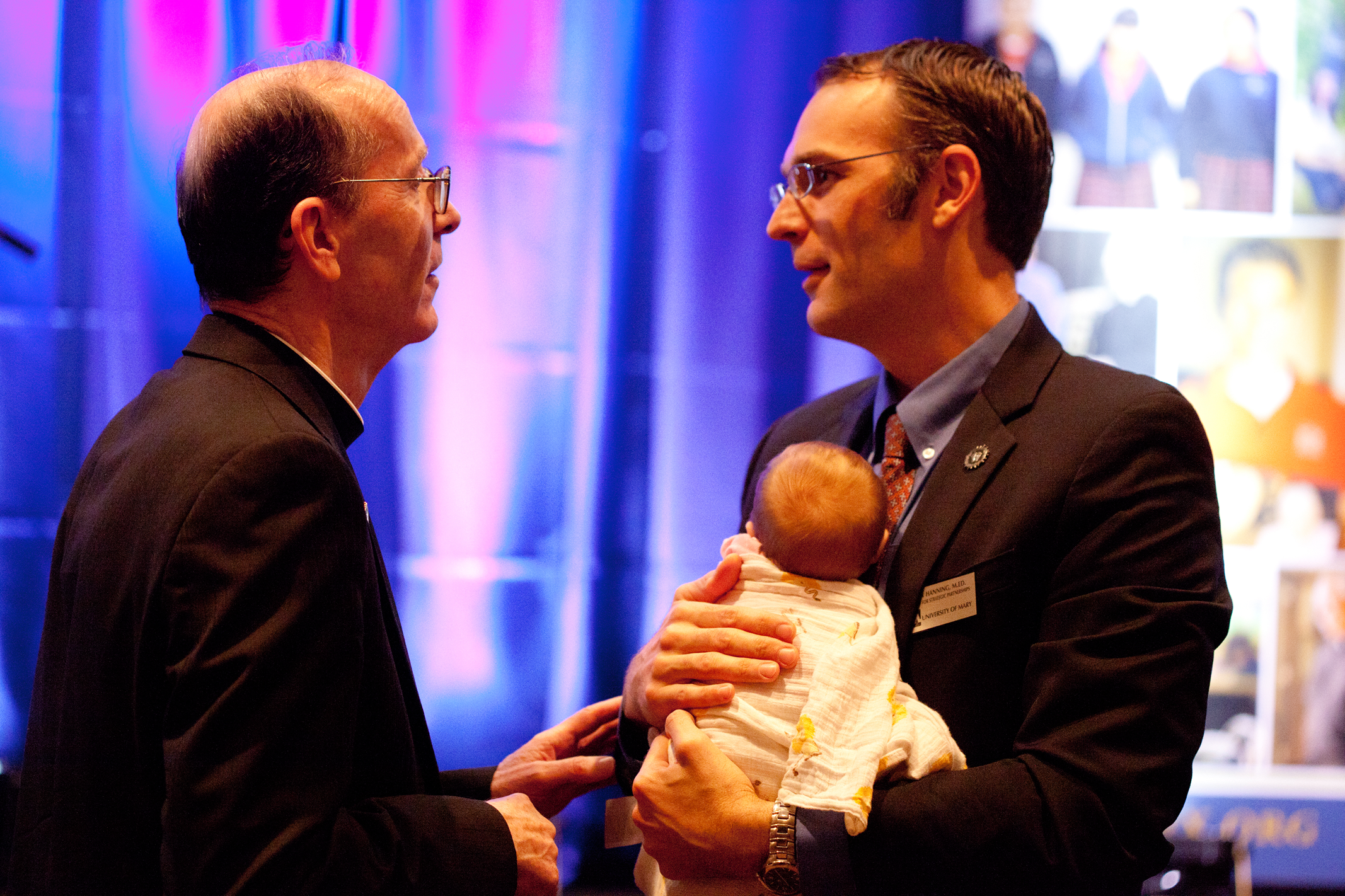 Dr. Hanning, Bs. Olmsted and newborn Therese, at 2015 State of Diocese Address.