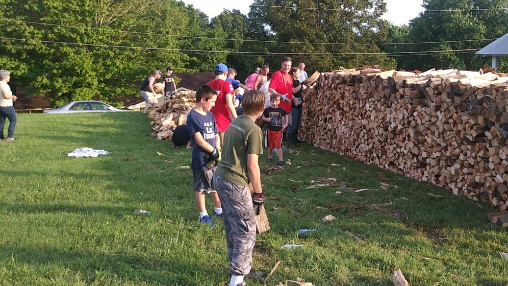 Wood stacking for St. Lawrence's 137th Annual BBQ.