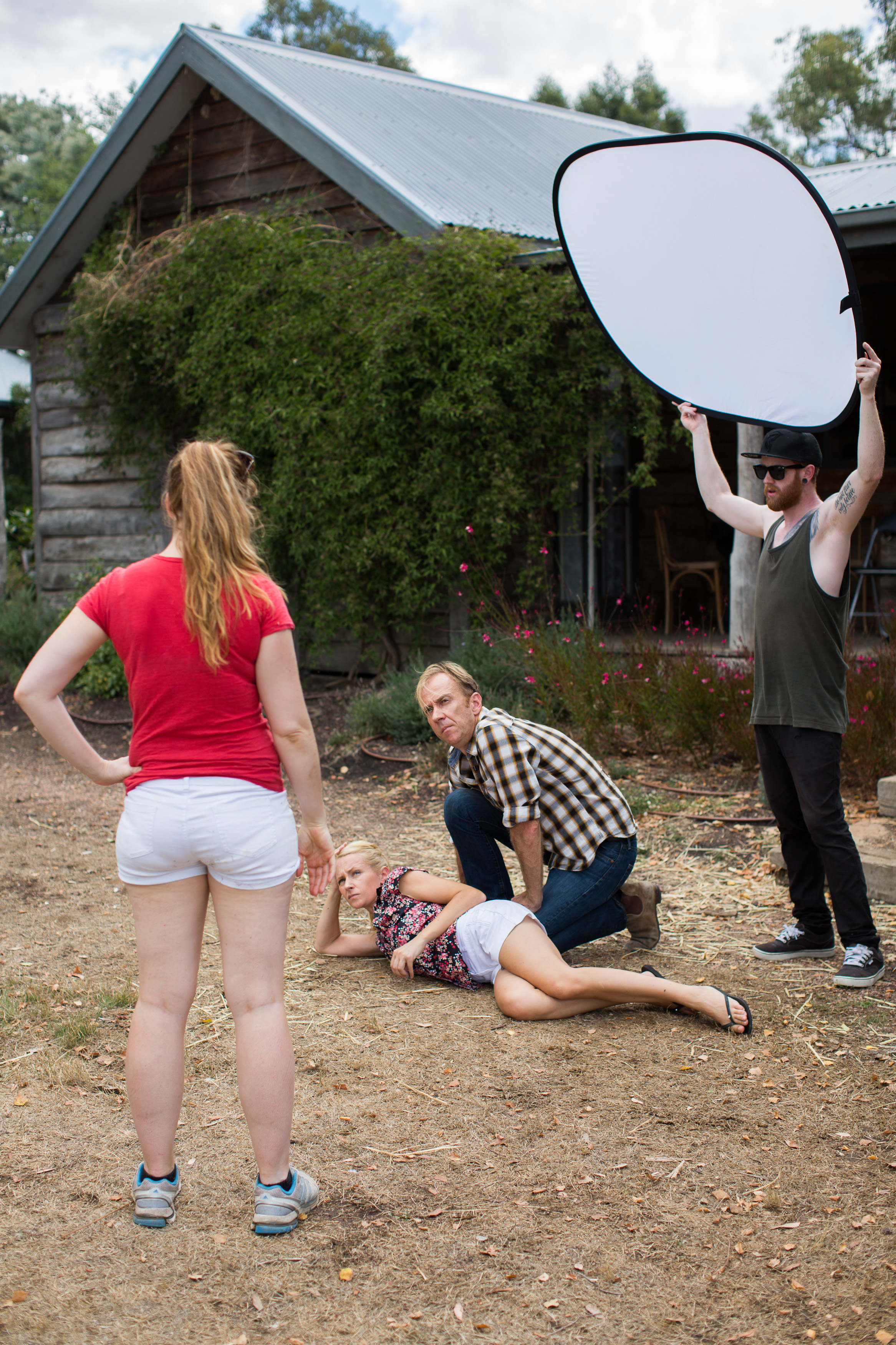 Director/Writer Dana Newell and cast blocking out a scene.