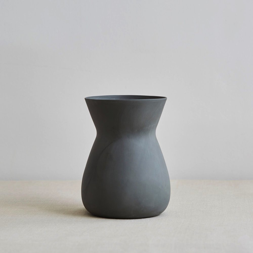 Betty Vase by Sue Pryke Dark Smokey Grey   We can't resist beautiful vases and this one is the kind that would proudly sit on our dining room table even when there aren't flowers in the house. How gorgeous is it?!