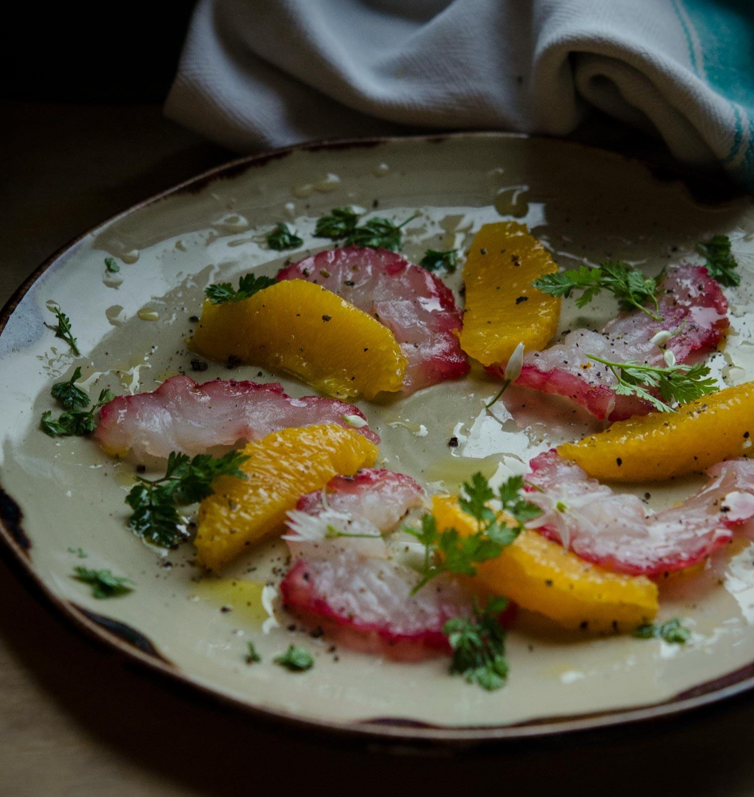 Beetroot and Orange cured pollock with orange segments and chervil