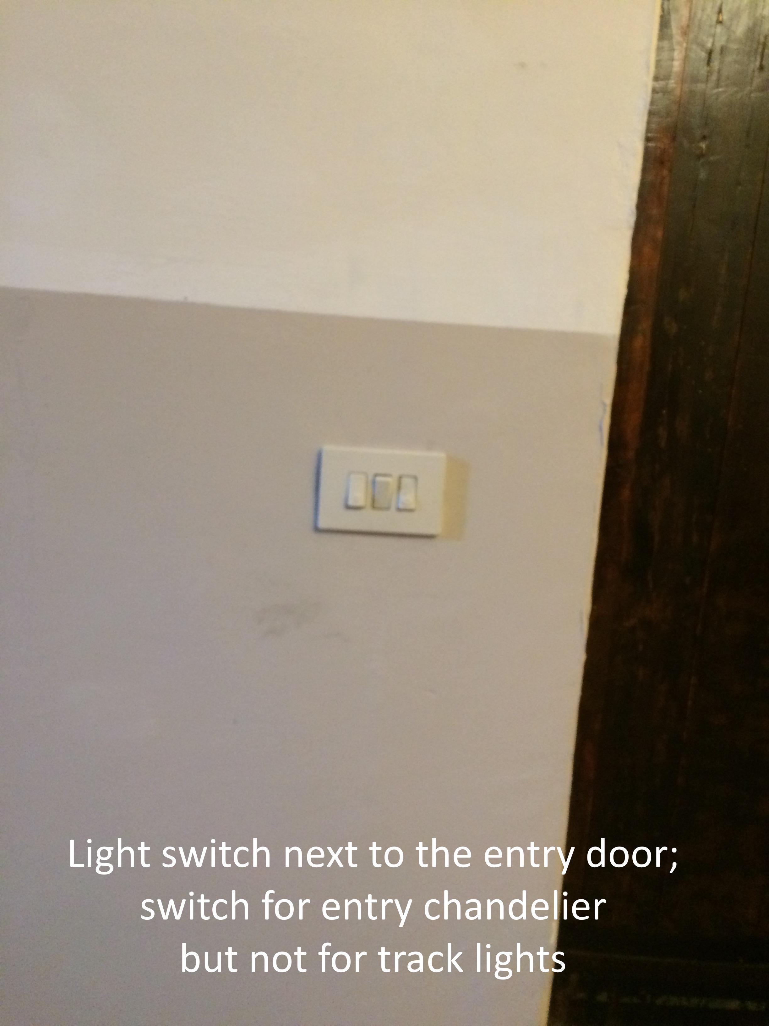 #11 Light switch inside front door.JPG