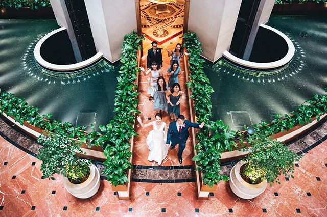 No matter the location, it's about capturing the awesomeness of the couple and their bridal party's energy that ultimately helps make a good picture! Just for fun, Julie and Simon led the way while everyone was asked to walk through while waving their hands like celebrities 😂 super fun shot and just one of the many memorable moments of their epic wedding day at @regentsingapore! Senior Associate 📸: @juanchan