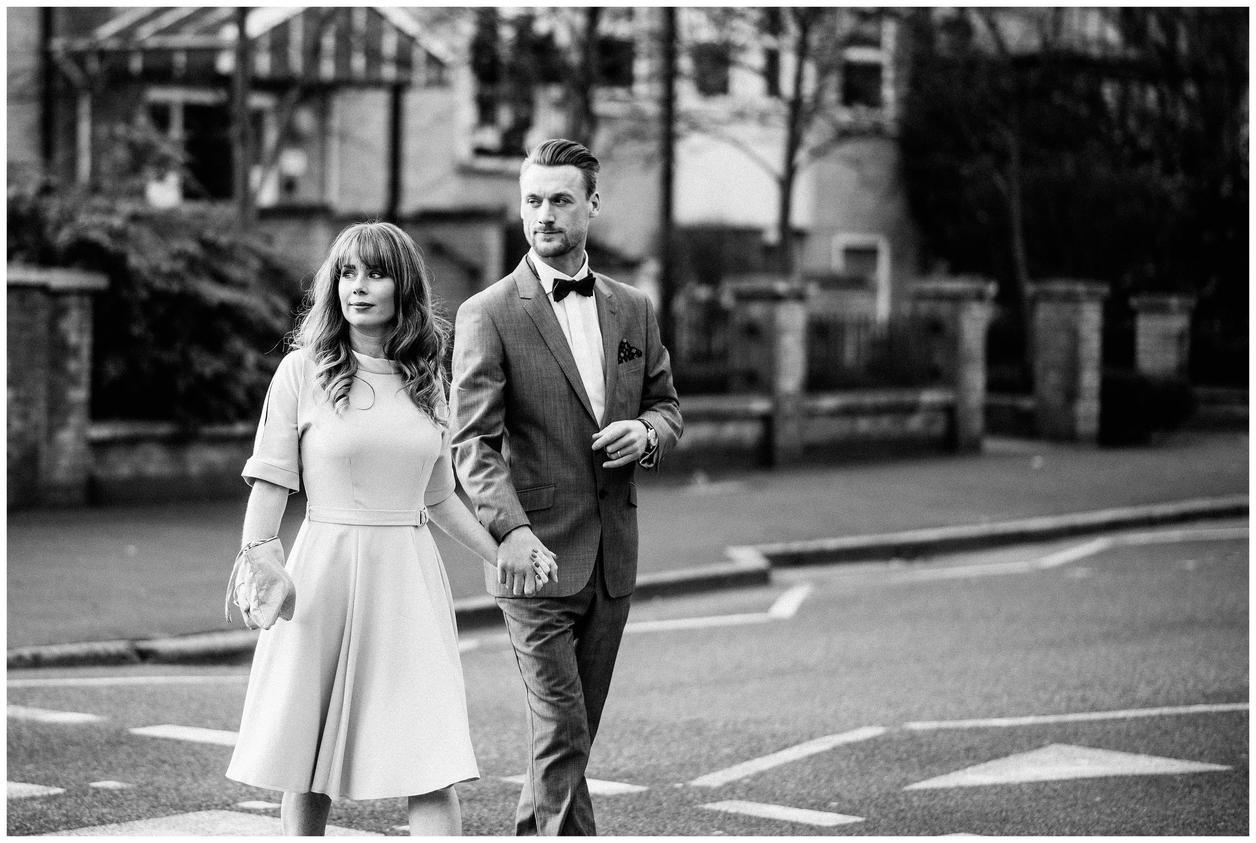 Married couple crossing the road Stoke Newington