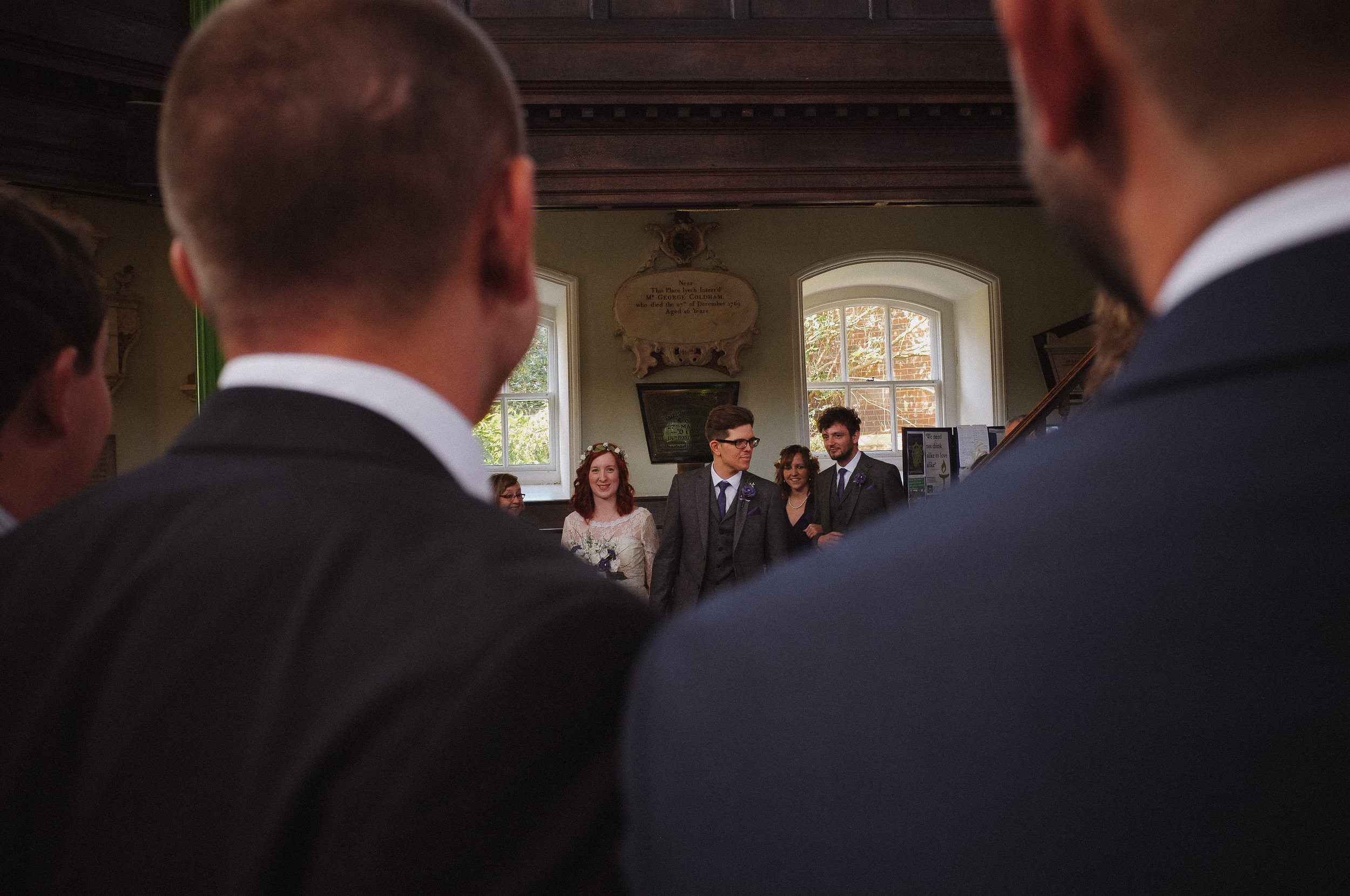 Married couple walking down the aisle at Octagon chapel norwich