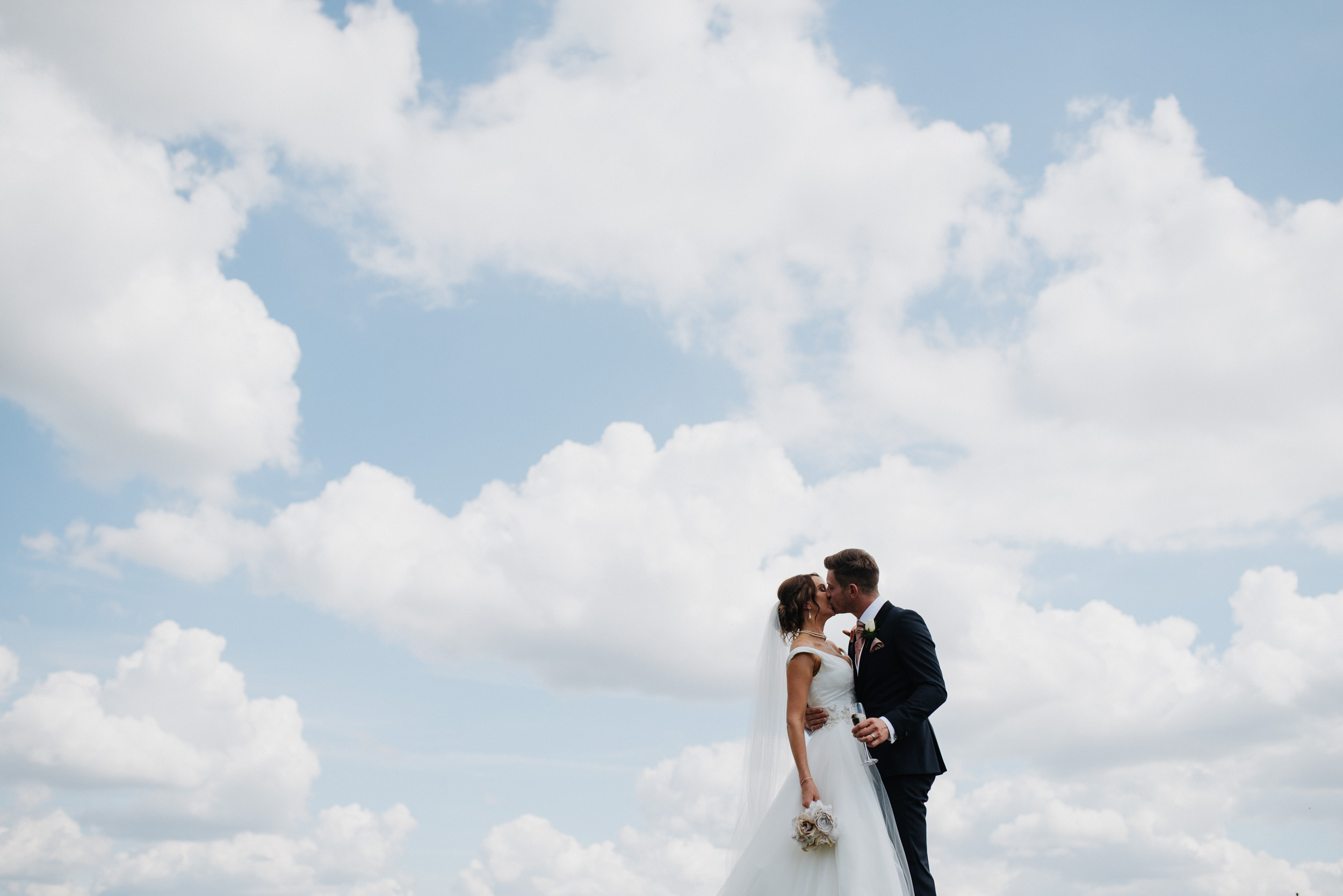 married couple portrait shoot in the clouds