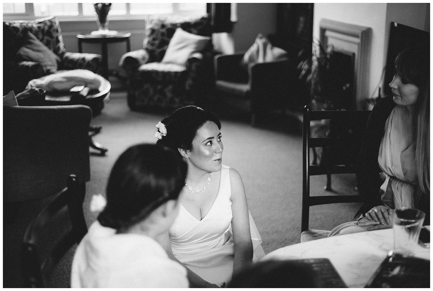 Bride and flower girls chatting during bridal prep at wedding in Hertfordshire