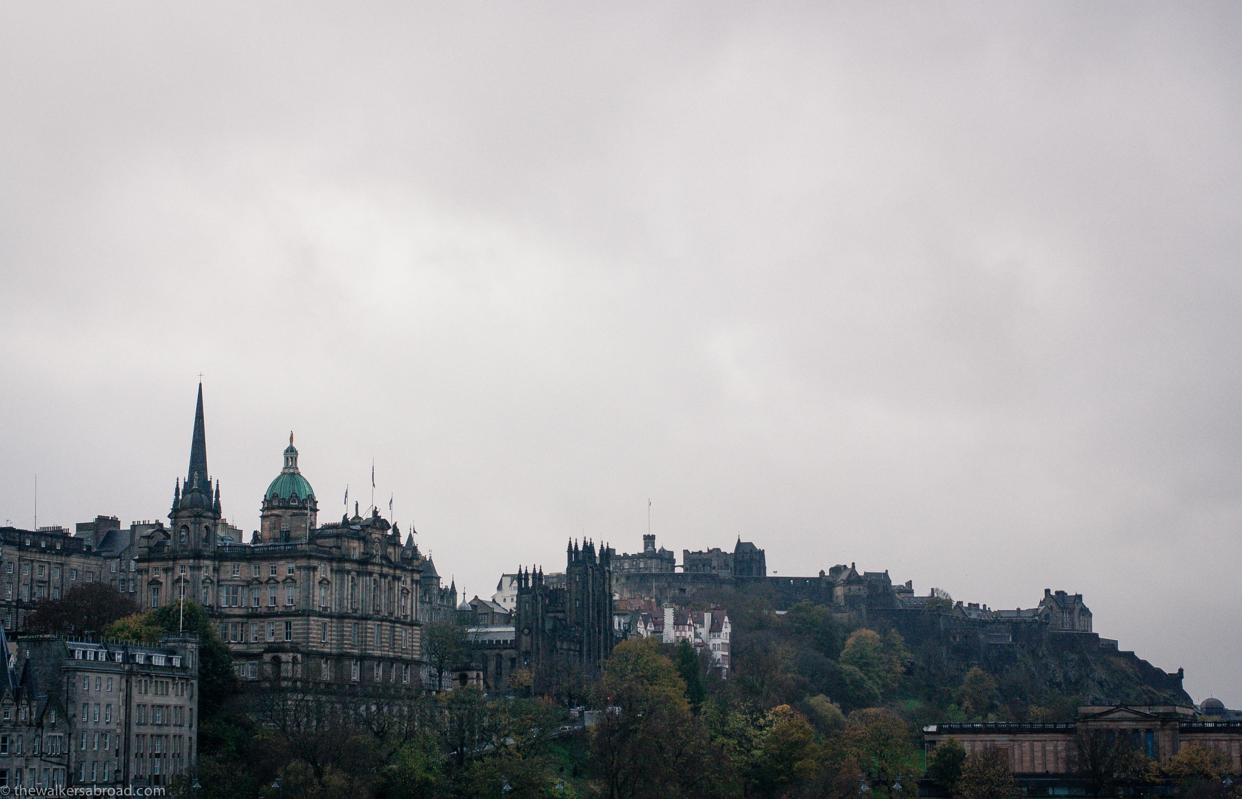 Edinburgh Castle is the walled building on the right center.