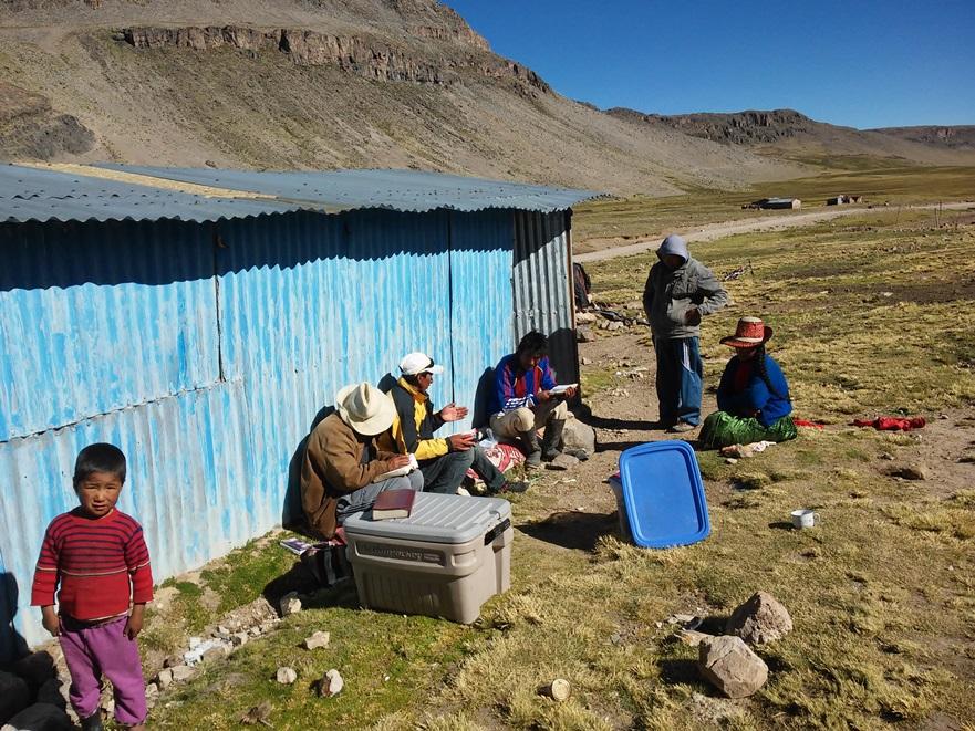 Carefully explaining the Gospel to this Alpaca shepherd family