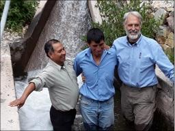 Camilo - Praise the Lord for his spiritual growth! Santiago & Brad baptizing him in the canal near his farm.