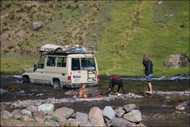 - Visiting remote villages can be challenging. This time we got stuck right in the middle of fording the river! We were on our way 20 hours later.