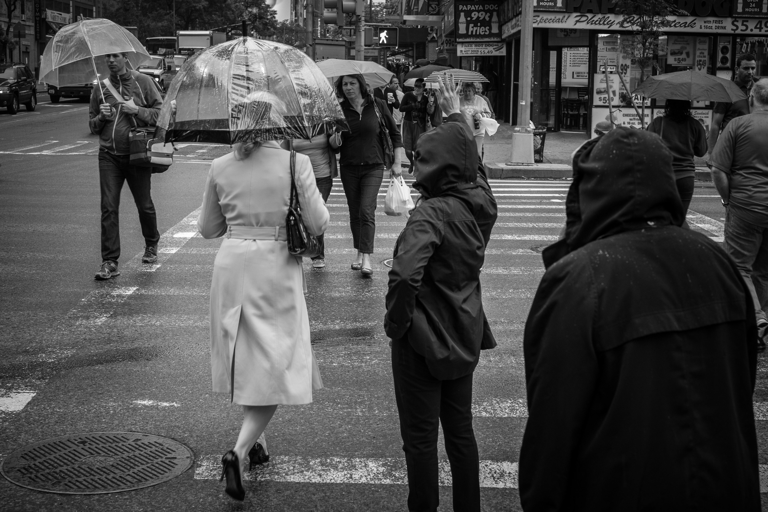 A little bit of rain didn't bother the X-Pro1,but did offer some nice scenes to photograph. When shooting on the streets in large cities, I find crosswalks and street corners offer plenty of opportunities. 1/125, f5.6 at ISO 640.