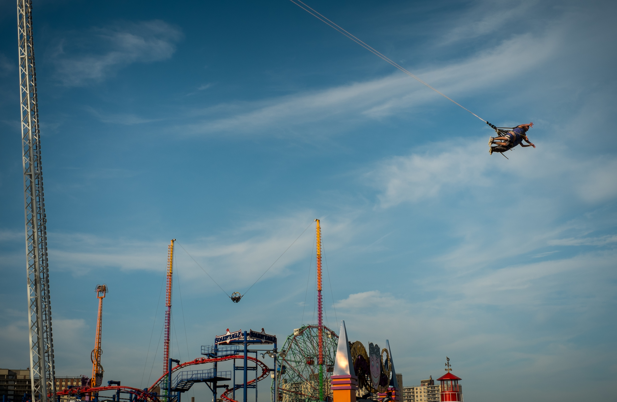 I used continuous shooting (burst mode) set to six frames per second (max for this camera) to capture this photo in Coney Island. 1/300, f11 at ISO 200.