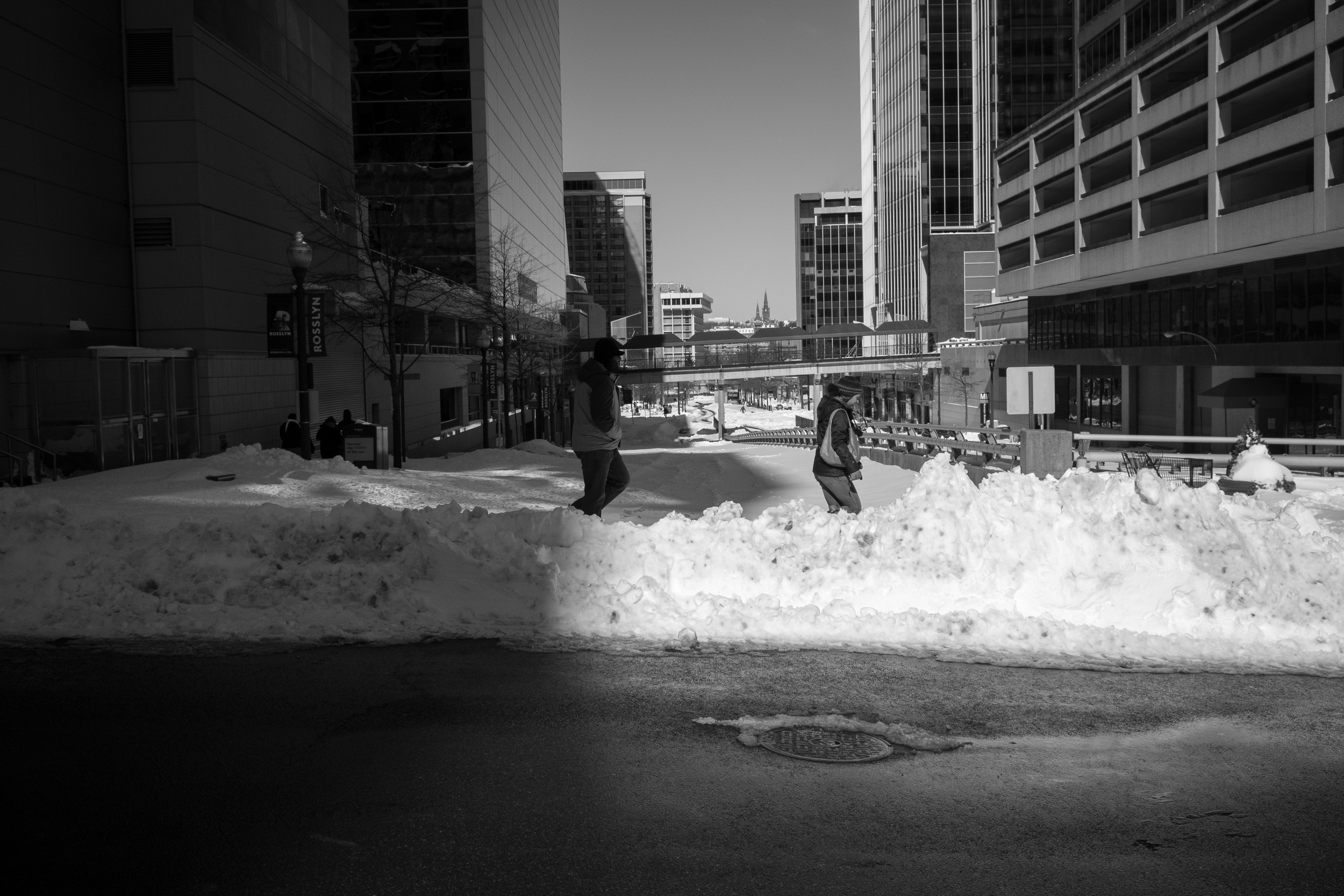 Even by noon, many side streets had not yet been plowed. I like the light in this photo, people emerging from the shadows; while some streets are cleared, many remain untouched and unexplored.