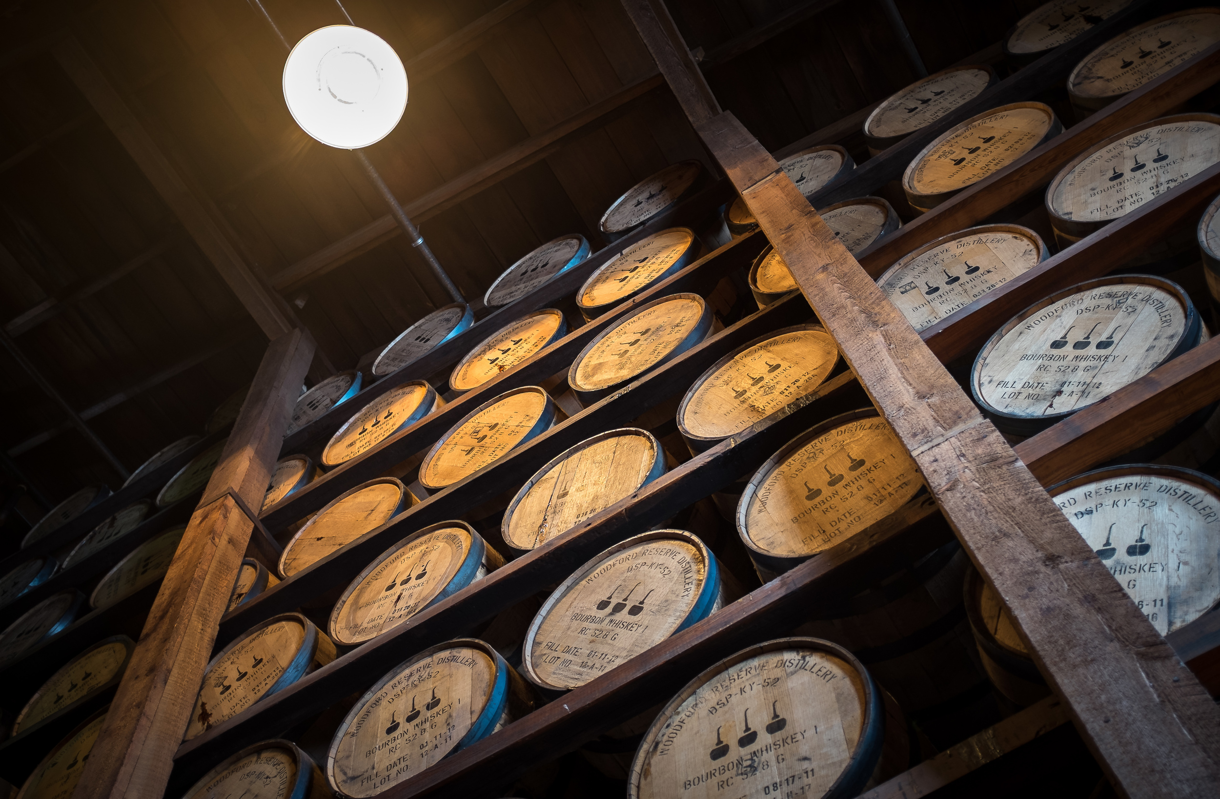 Bourbon barrels aging at Woodford Reserve. 1/15 @ f2.0, ISO 400.
