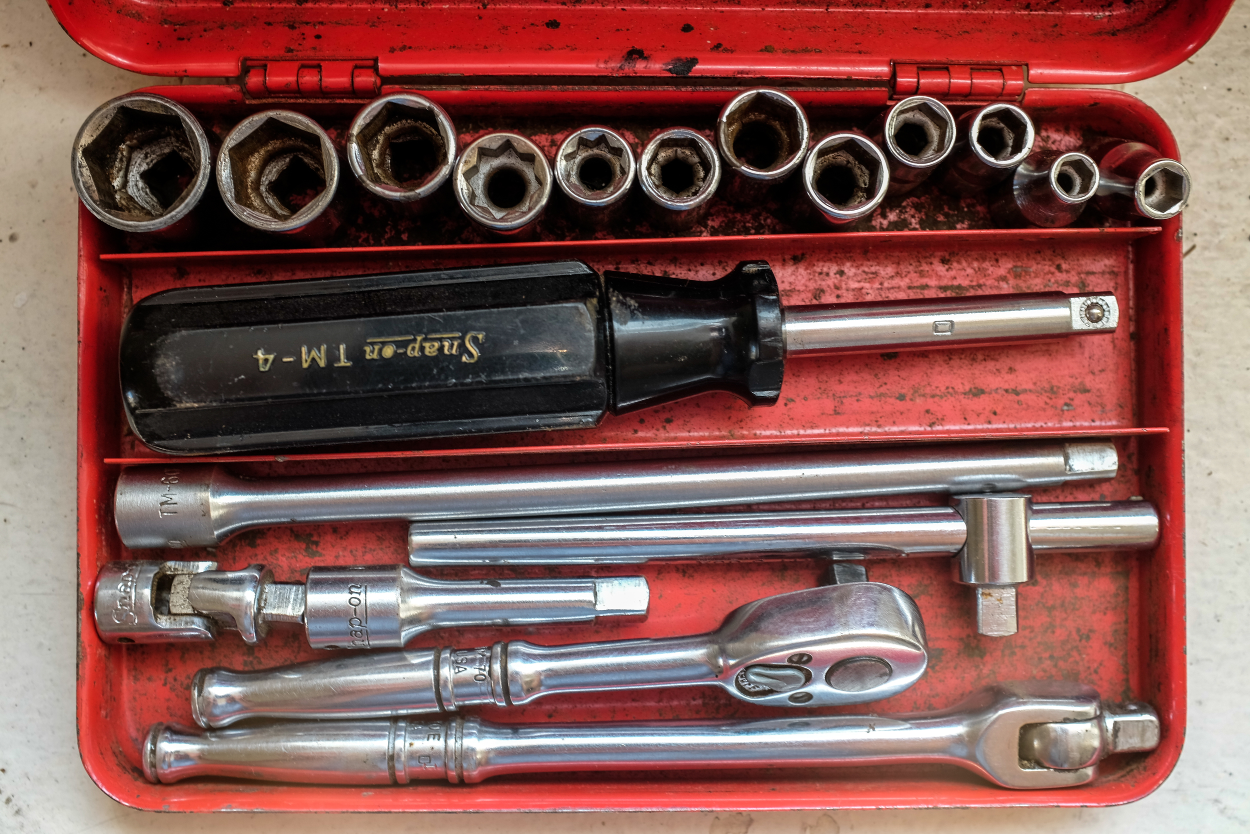 My late Grandfather's Snap-on socket set shot at 1/25, f4.5 at ISO 200, macro setting.
