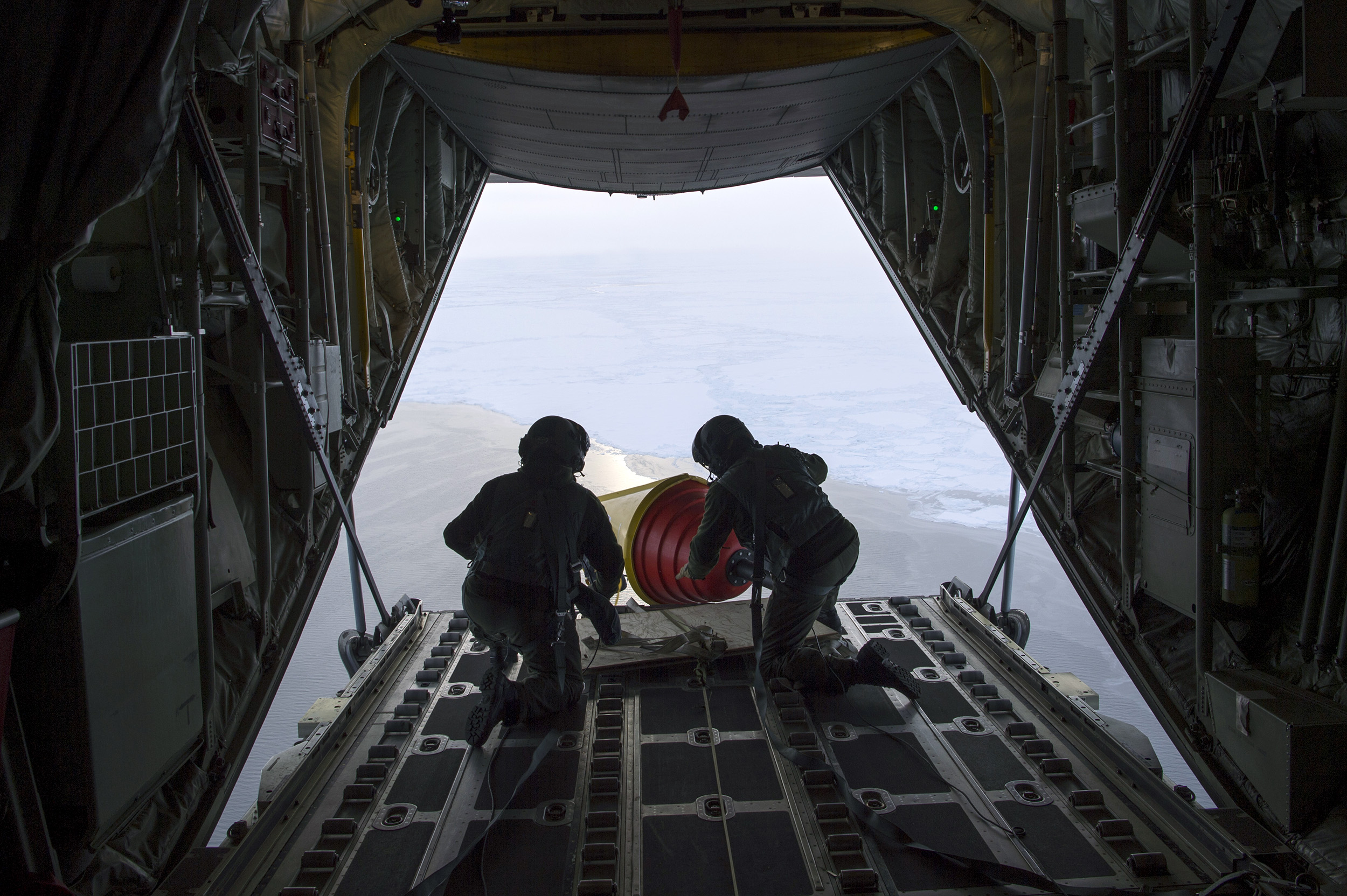 ARCTIC OCEAN  - An Air-Deployable Expendable Ice Buoy (AXIB) is deployed in the high Arctic near the North Pole from a Royal Danish Air Force C-130 aircraft operating out of Thule Air Force Base in Greenland, as part of the International Arctic Buoy Program (IABP). The IABP is a conglomeration of global participants that maintain a network of drifting buoys in the Arctic Ocean that provide meteorological and oceanographic data for real-time operational requirements and research purposes.