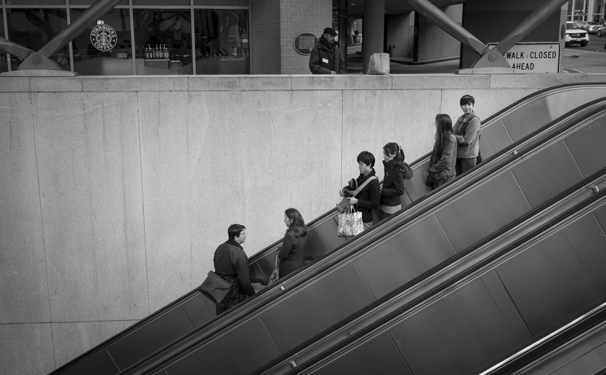 Think three-dimensionally. In this photograph of passengers entering the Foggy Bottom metro I used the rule of thirds to both place the subjects in upper right and the three diagonal lines of the escalators to draw you in to the frame. Fujifilm X100S, 1/250 @ f8, ISO 400.