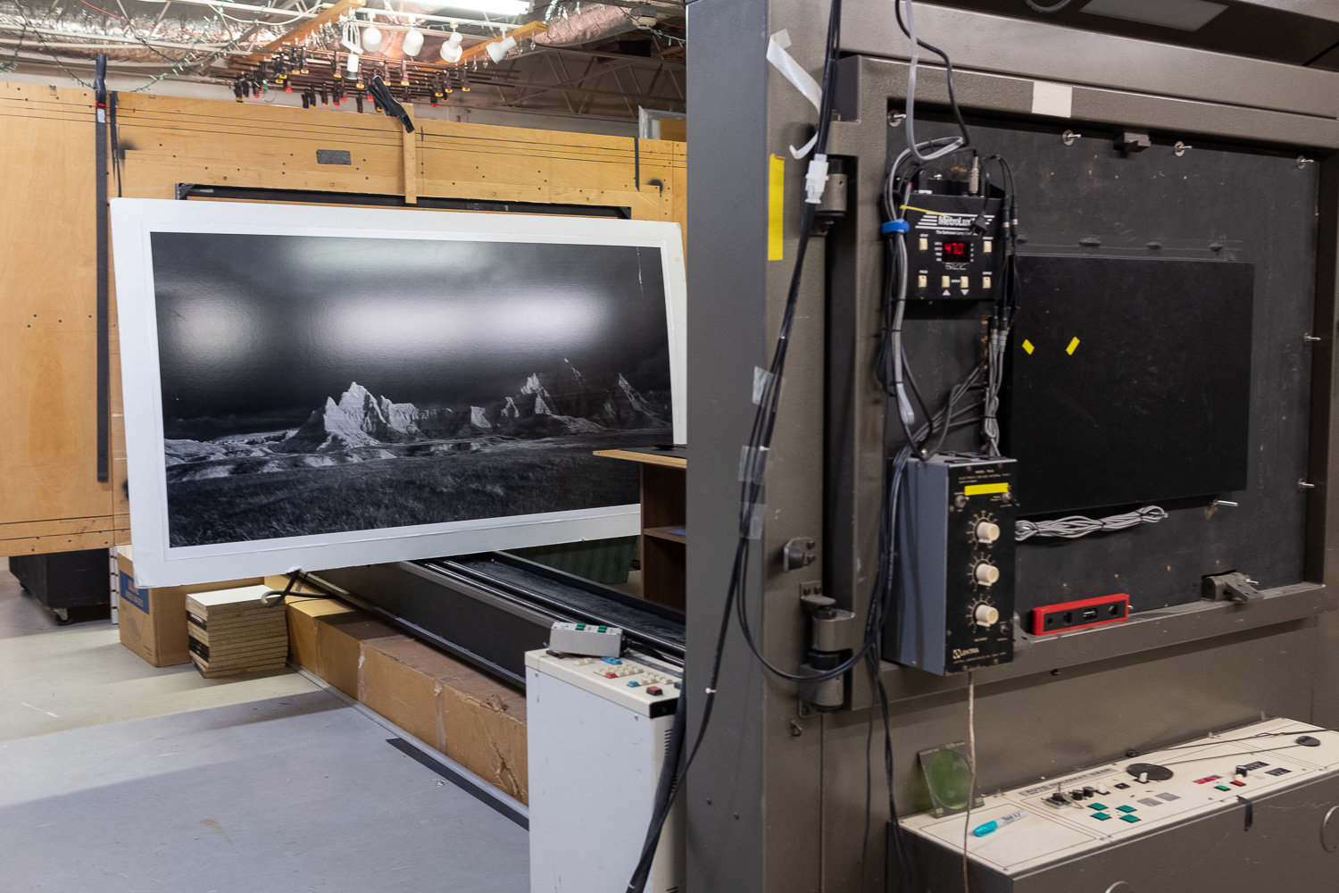 This huge rail camera turned enlarger, is just one of a unique collection of enlargers that occupy Clyde's darkroom.