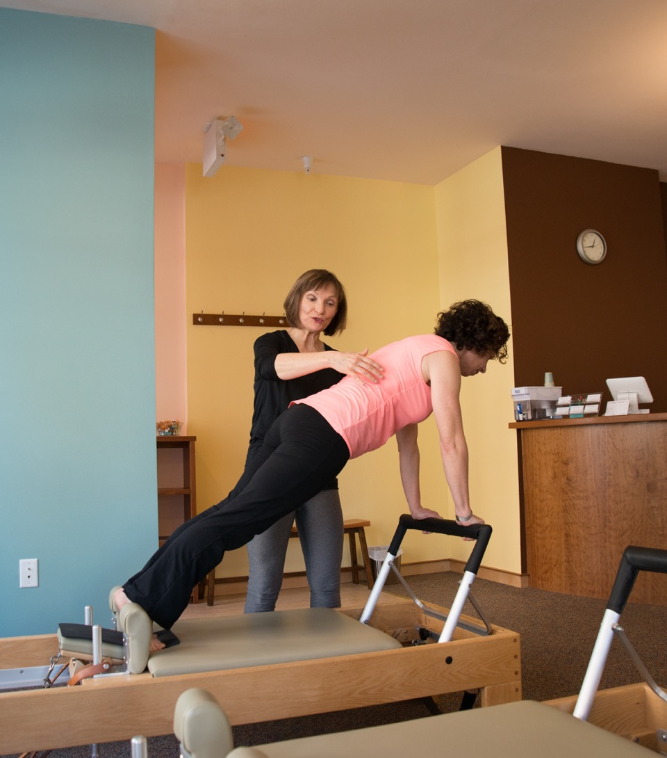 Susan teaching a private on the reformer