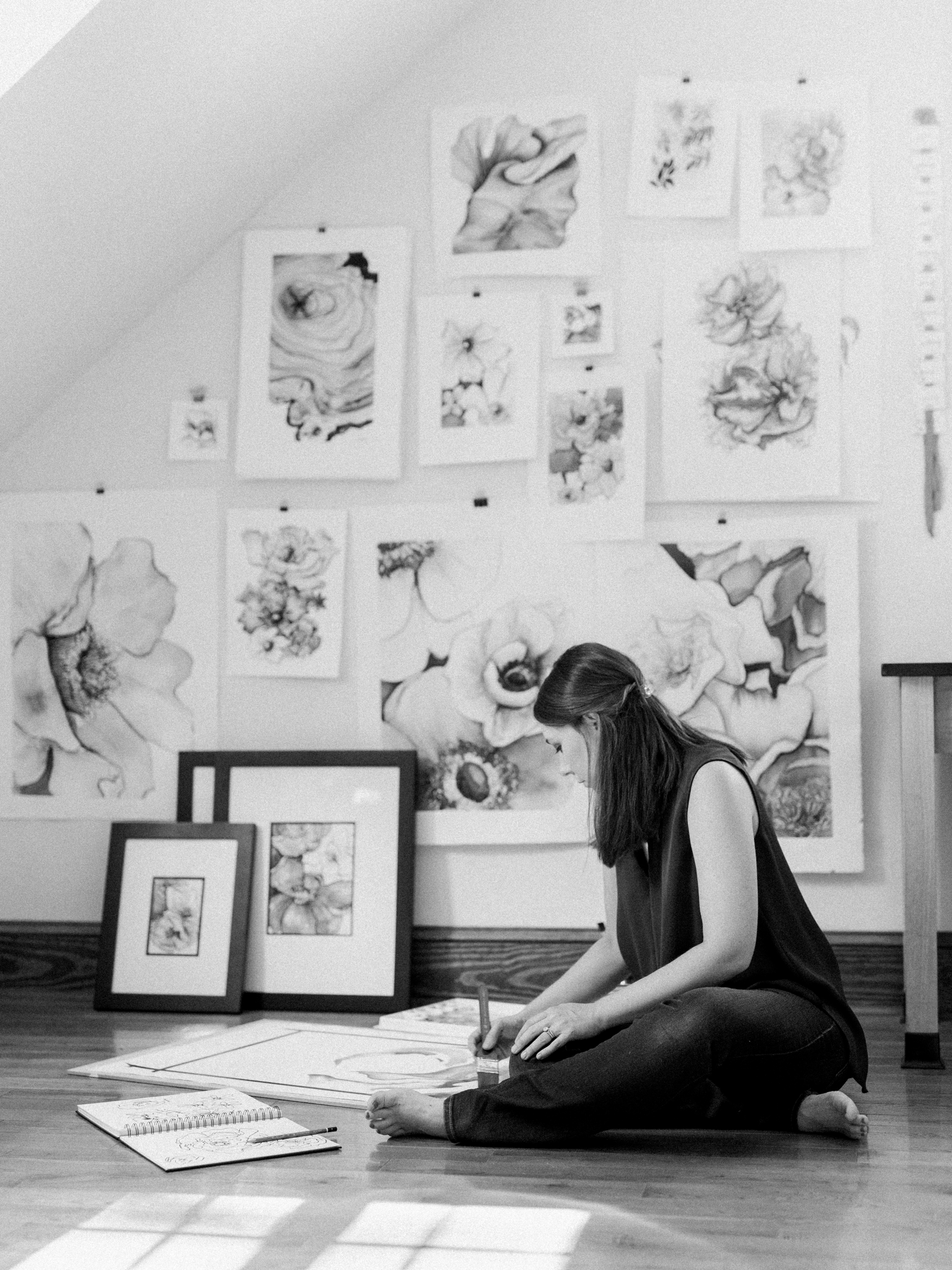 Atlanta artist Courtney Khail | in the studio painting | photo by Elle Golden Photography