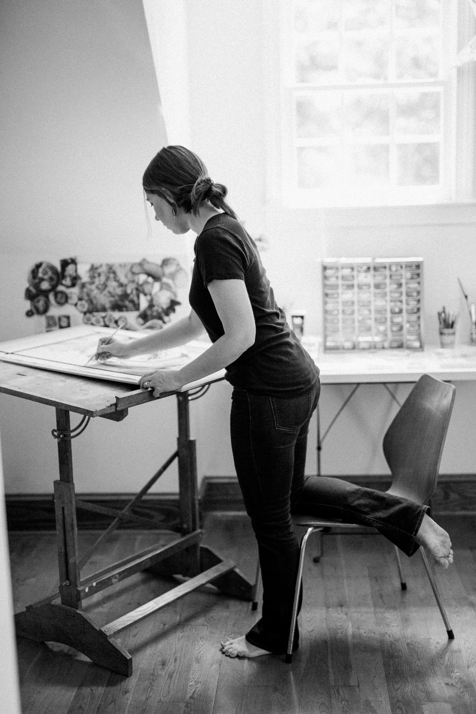 Atlanta artist Courtney Khail | painting in the studio | photo by Elle Golden