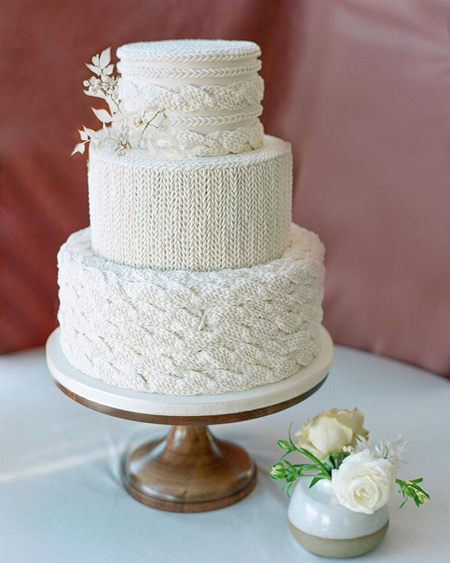 """#Hygge - a quality of coziness and warmth that creates a feeling of contentment or well being, the art of building sanctuary and community.  For this mama's cozy hygge themed shower we created this beautiful """"knitted"""" cake that took over 50 hours to complete! This is one of my favorite cakes EVER and I couldn't be more proud of the result.  photography: @cassidybrookee planning: @laurelandrose floral: @fawnsleap and @kitzel CAKE (!!!): Yours Truly decor & rentals: @yonder_house paper goods: @lotusandash draping: @lightinganddesignbyscott wool blanket: @broadwick_fibers linen: @latavolalinen"""