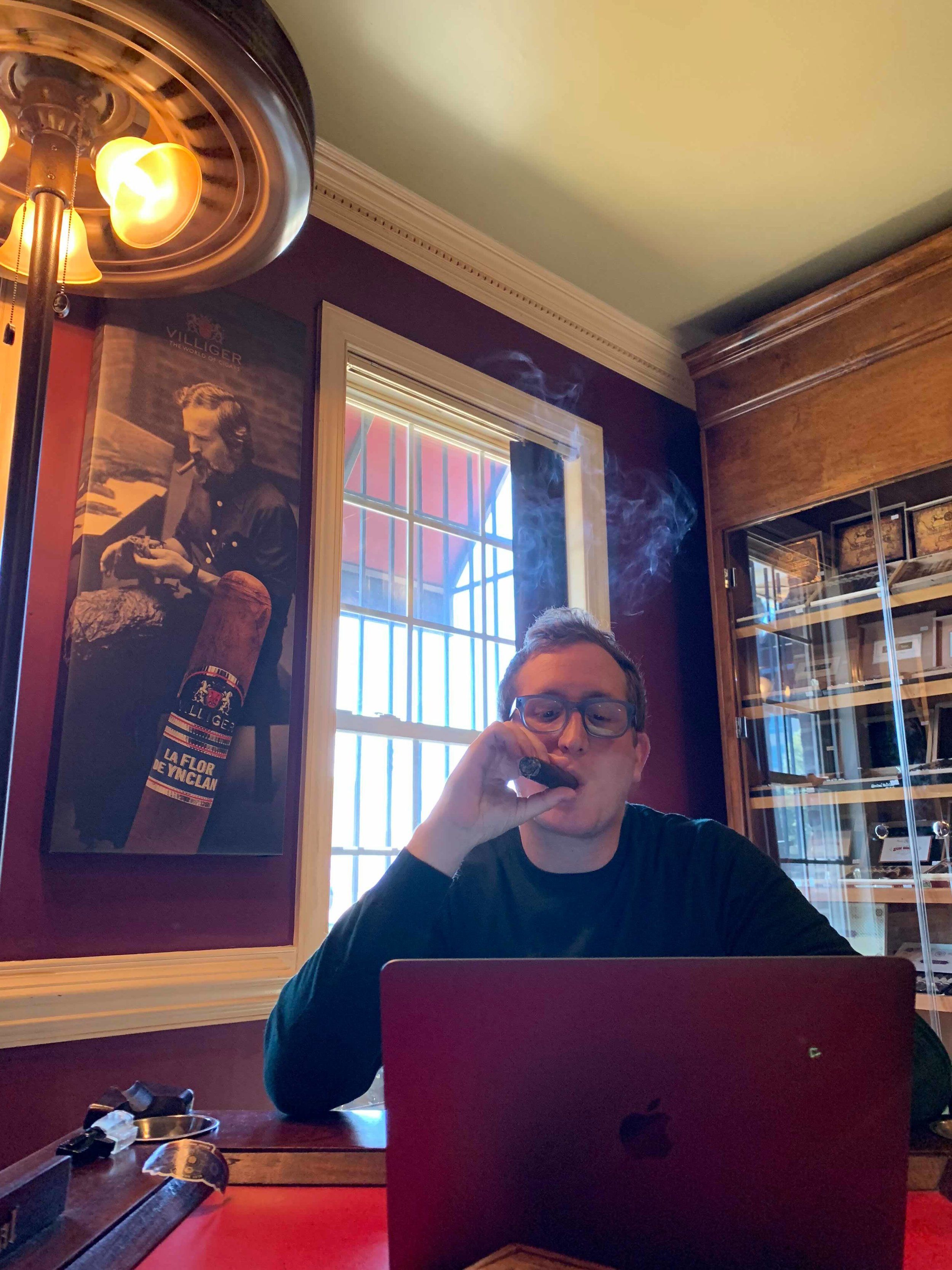 Still working, even in the cigar lounge!