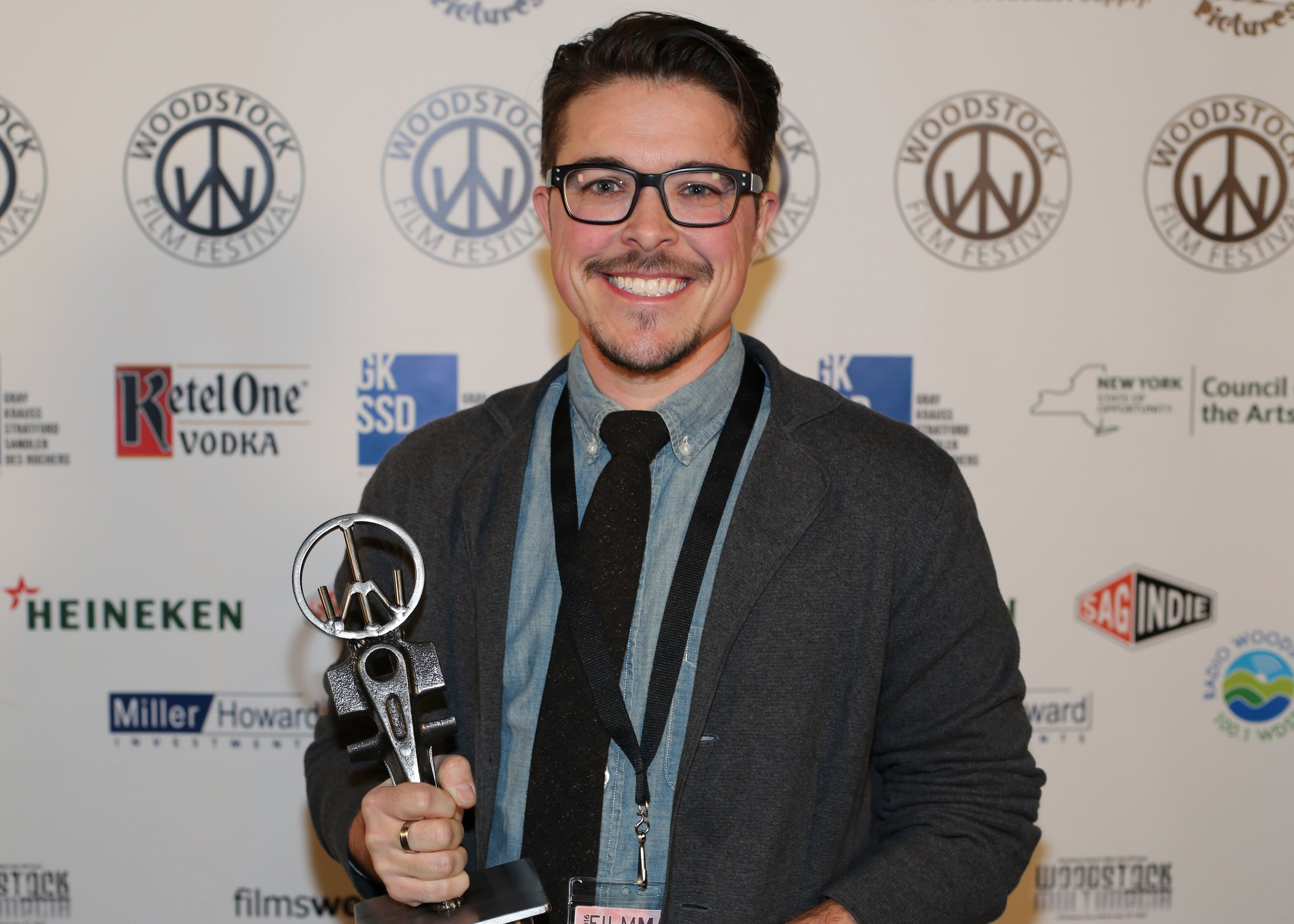 Kyle Ranson-Walsh, associate producer of   Real Boy,  with The James Lyons Editing Award for Documentary Feature