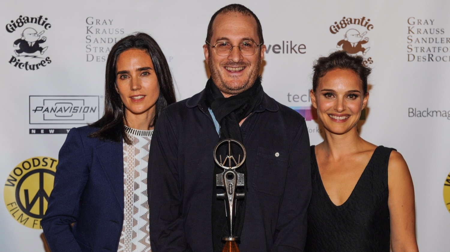 Jennifer Connelly and Natalie Portman present Darren Aronofsky with the Honorary Maverick Award at the 2014 Woodstock Film Festival.