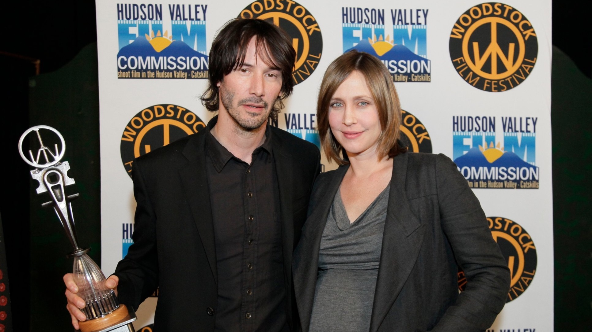 Keanu Reeves receives the Excellent in Acting Award presented by Vera Farmiga at the 2010 Woodstock Film Festival.