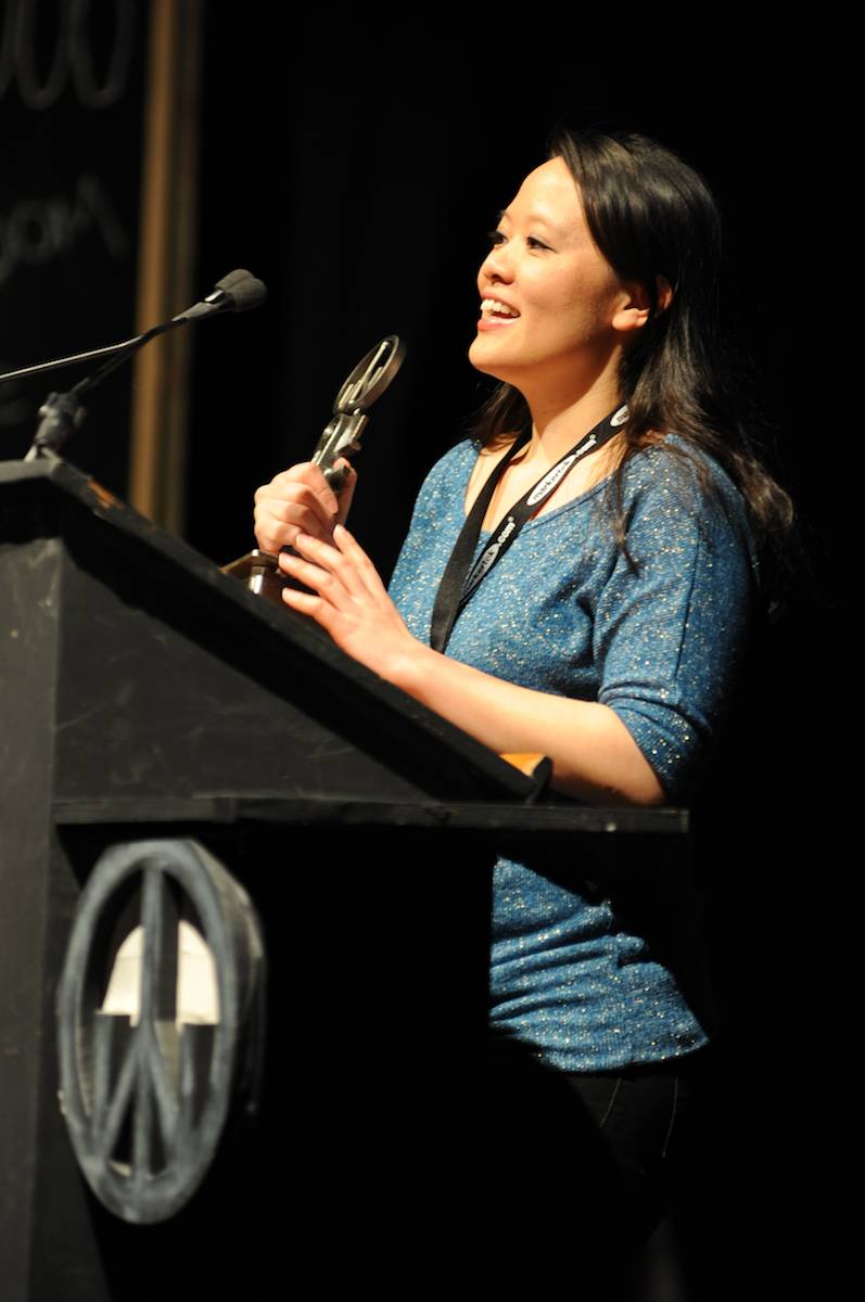 Producer Mynette Louie accepts the award for Best Feature Narrative CALIFORNIA SOLO. Photo by Jacob Hutchings