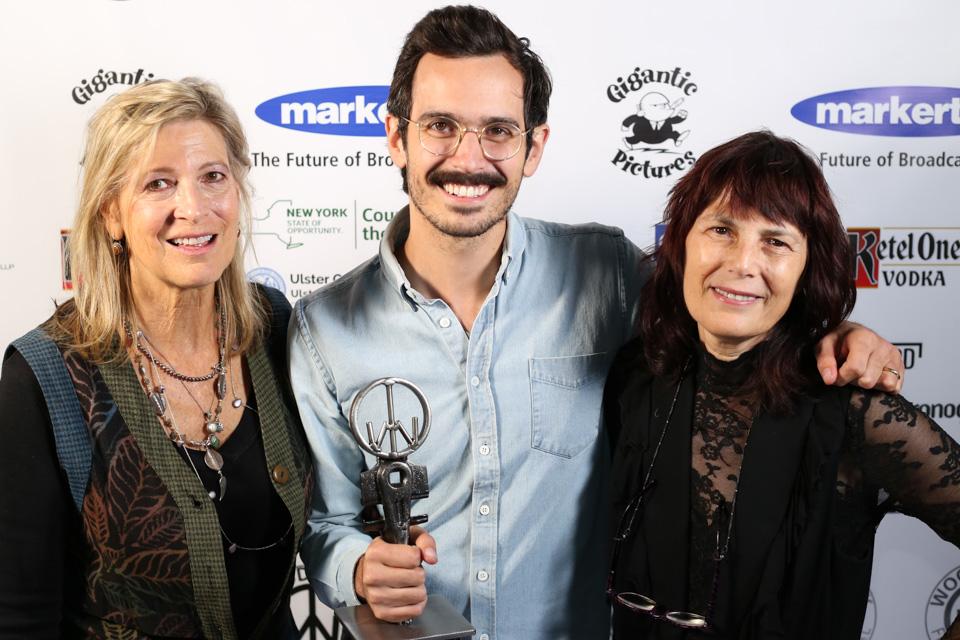 SPELL director Brendan Walter (center) after winning the 2018 Woodstock Film Festival's Haskell Wexler Award for Best Cinematography.