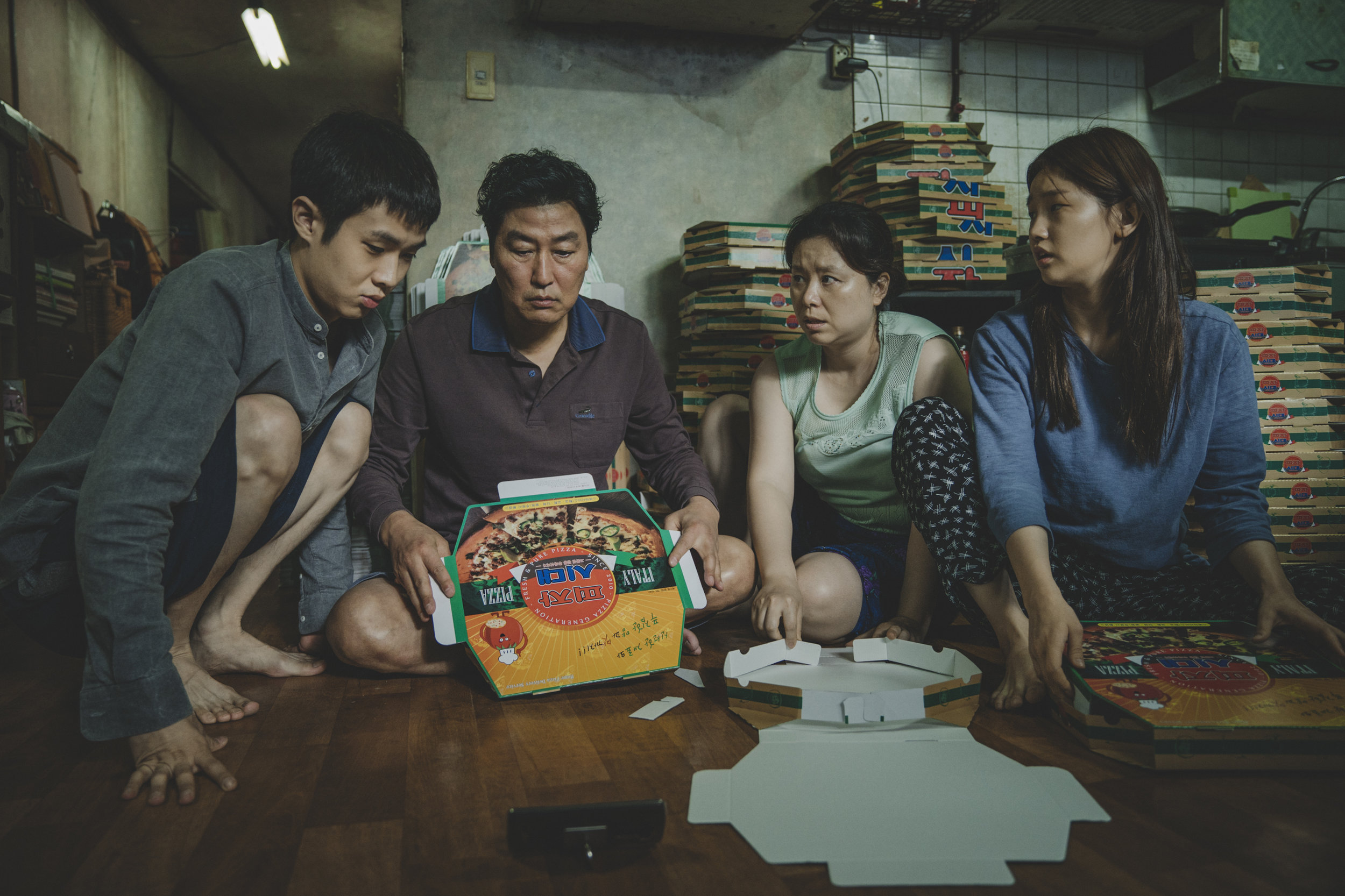 The Kim Family (Woo-sik Choi, Kang-ho Song, Hye-jin Jang, So-dam Park) in Parasite. Courtesy of NEON + CJ Entertainment.jpg