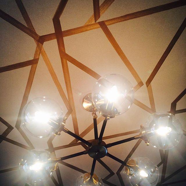 A little flare above. #playroom coming along! #wallpaper #ceiling #interiordesign #interiordecor #modern #lighting #notafraidofpattern #ilovemyjob #kidswithstyle