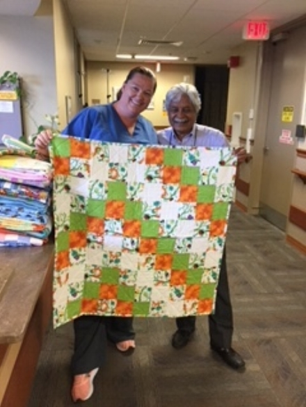 Several baby quilts were donated to the maternity ward at OSF St. Elizabeth Hospital in Ottawa, IL in July of 2018. Pictured here are Dr. Dave and Nurse Sandra Crawley receiving the quilts.