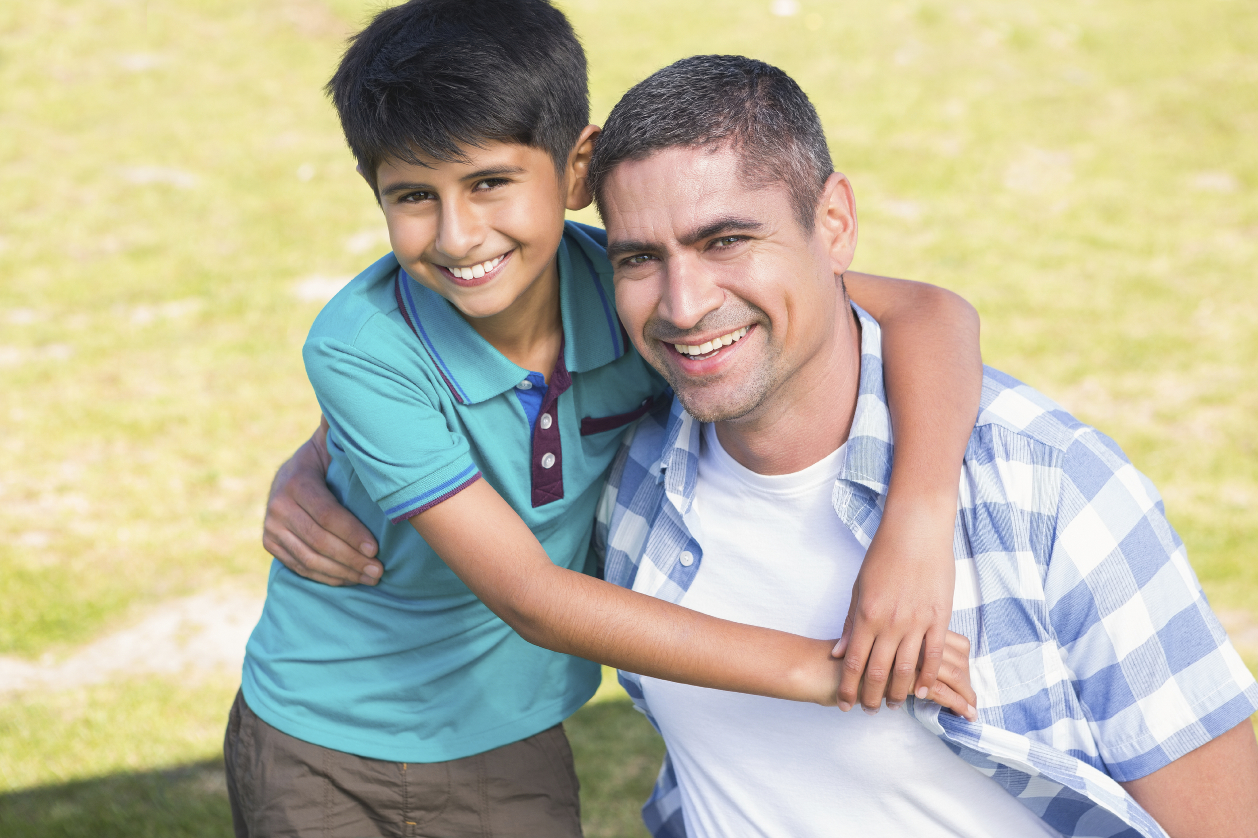 Smiling son with his dad outside