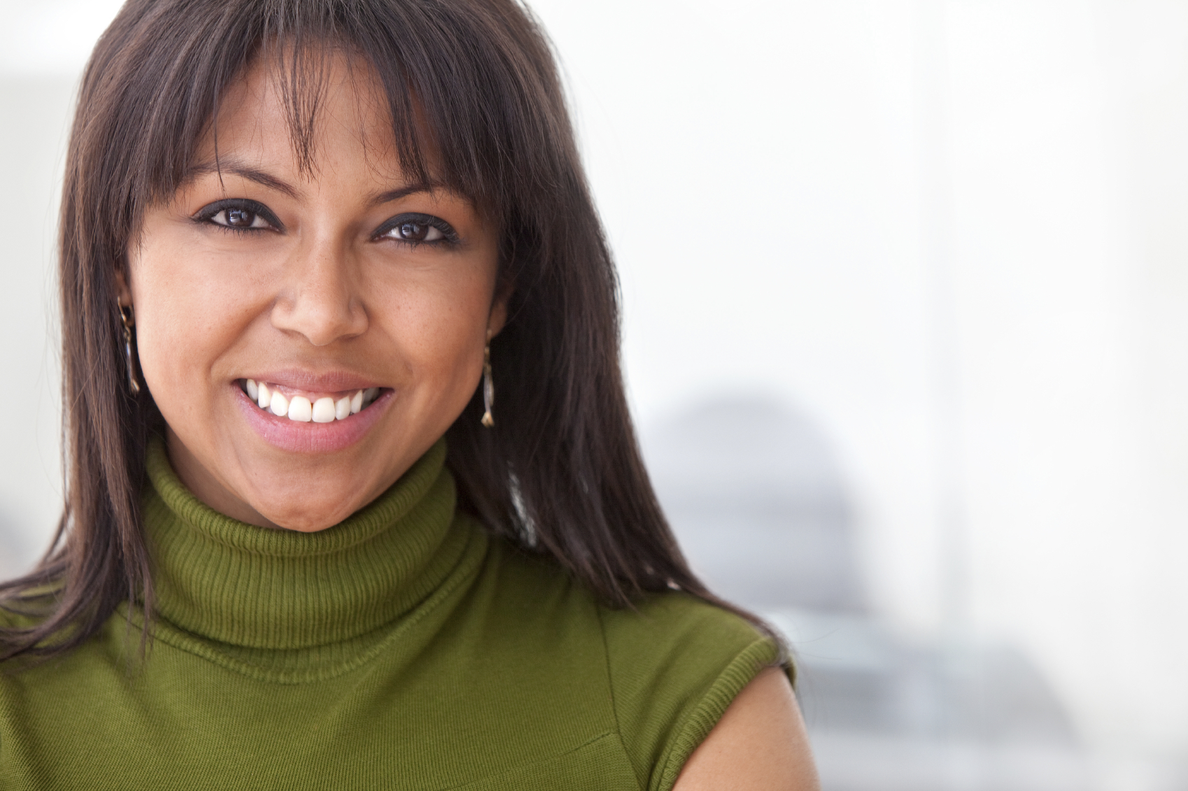 Middle age woman in green blazer smiling