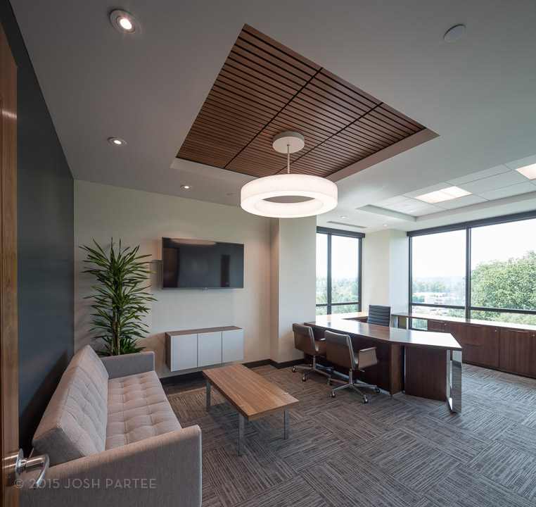 The CEO office offers 3rd floor views, room for entertaining clients, and contemporary furniture