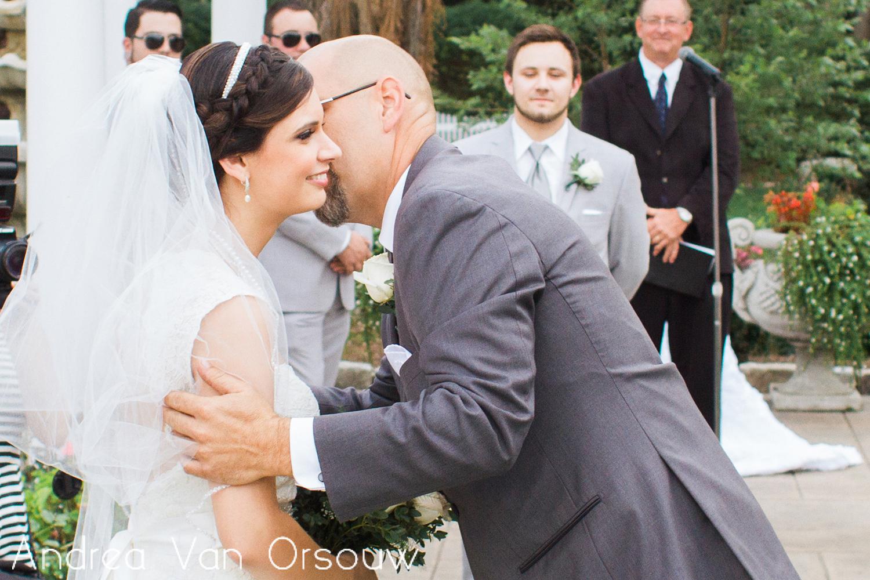 father_kissing_bride.jpg