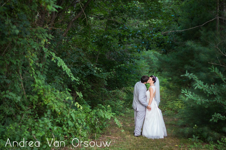bride_groom_in_woods_kissing.jpg
