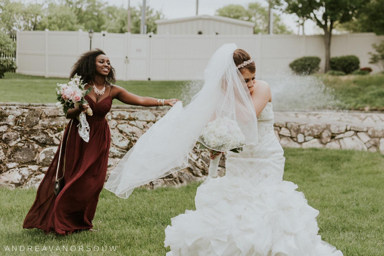 veil_wrangling_bridesmaid_bride_playful_goofy_fun_ connecticut_rhode_island_hartford_wedding_photographer.jpg