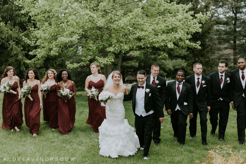 fun_bridal_party_walking_connecticut_wedding.jpg
