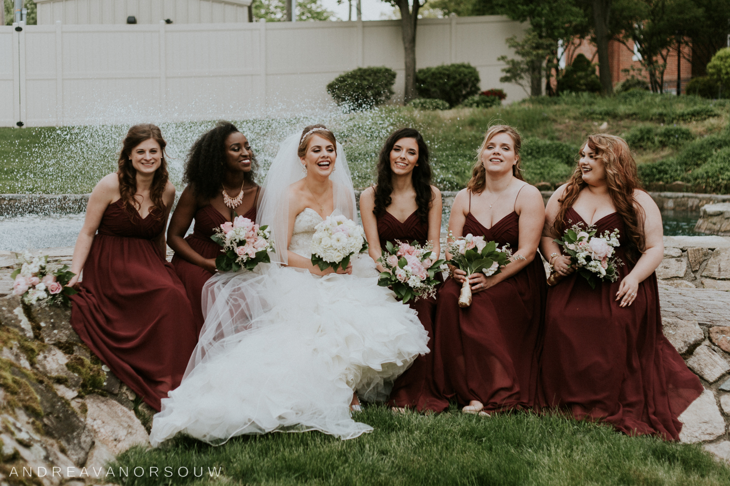bridesmaids_bride_laughing_outdoors_red_dresses_bridal_party_ct_wedding_photographer.jpg