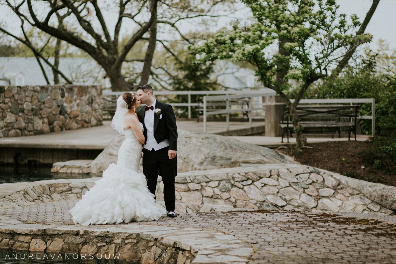 bride_groom_kiss_wide_angle_coast_guard_academy_rhode_island_photographer.jpg
