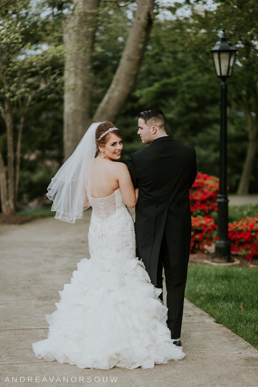 wedding_couple_bridal_portrait_over_shoulder_walking_pose_connecticut_wedding_photographer.jpg