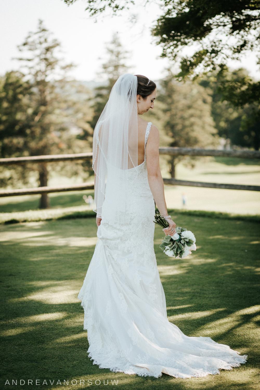 bride_portrait_lace_dress_bouquet_couple_poses_bride_groom_husband_wife_wedding_rhode_island_connecticut_new_england_weddings.jpg