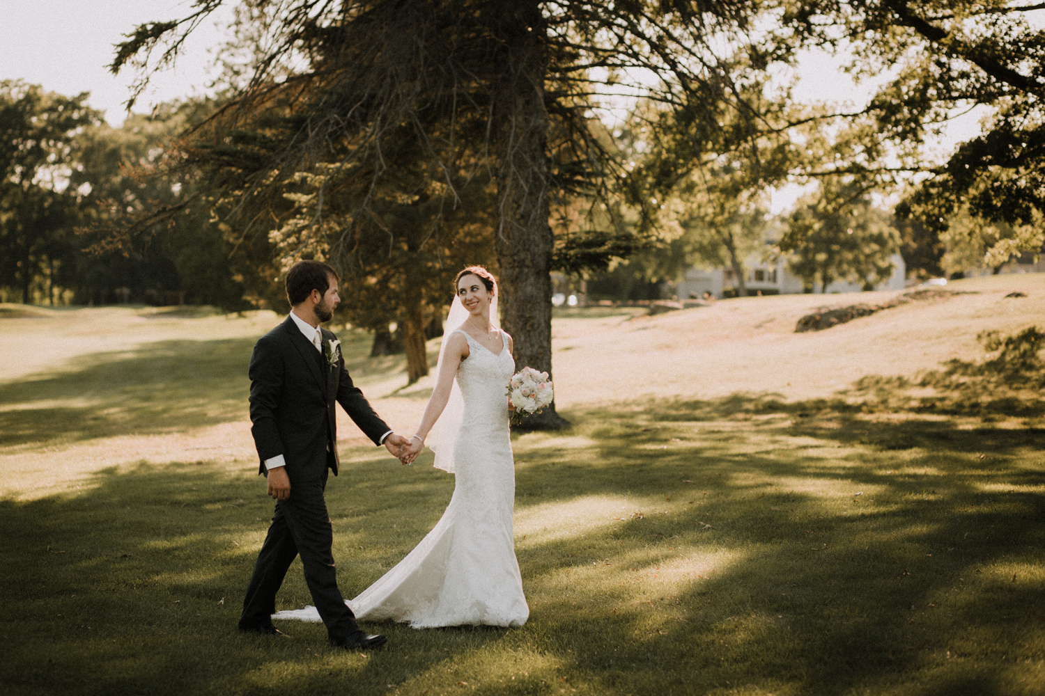 valley _country_club_walking_smiling_bride_groom_bouquet_outdoors_trees_dress_outdoors_connecticut_rhode_island_massachusetts_new_england_wedding_photography_photographer_natural_laid_back_fun_adventure_light_engagement_session.jpg
